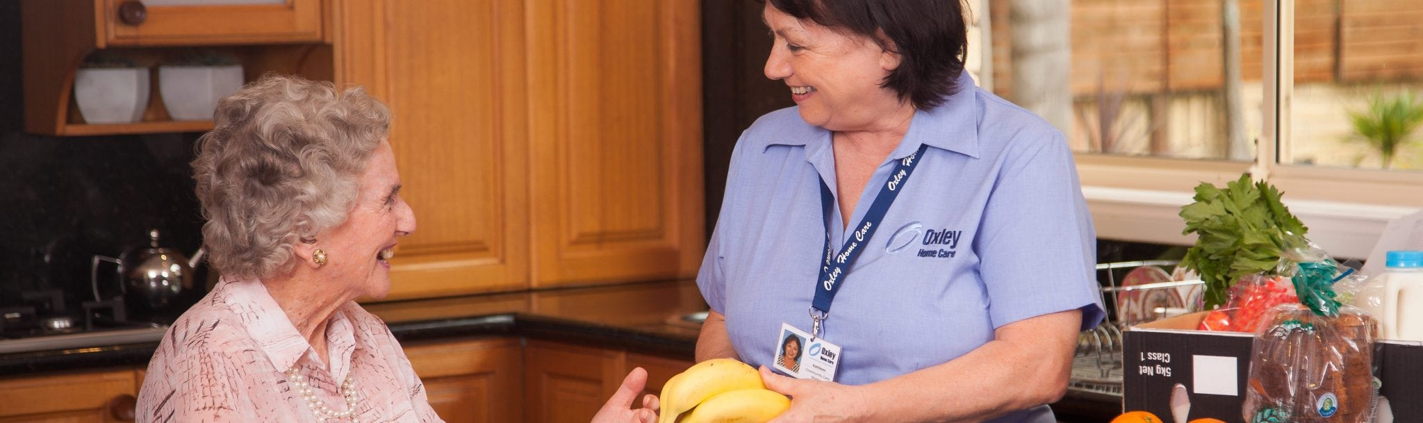 Carer undertaking meal preparation with a client